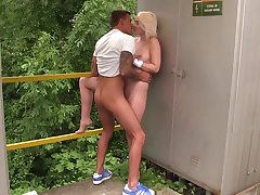 Girl on fire enjoys sexy with boyfriend in outdoor