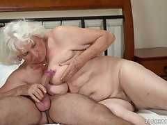 Horny granny gets her pussy serviced by a young person